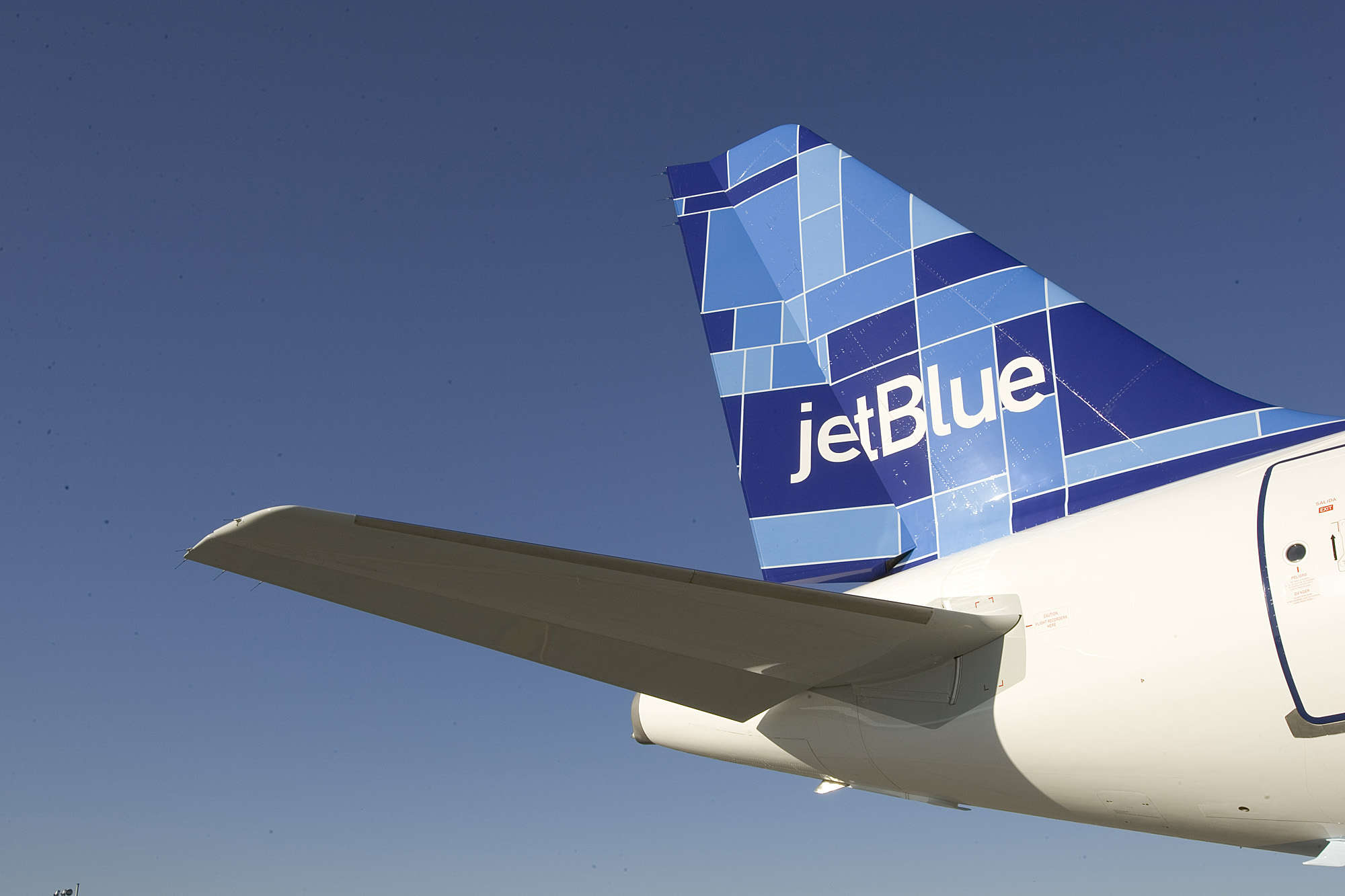 JETBLUE TURNS FIVE;  TAKES DELIVERY OF 71ST AIRBUS A320 New York, NY (February 11, 2005) Ð JetBlue Airways [NASDAQ: JBLU] today turned five.  The airline commenced service at New YorkÕs John F. Kennedy International Airport on February 11, 2000, with a ceremonial flight to Buffalo, NY, and back before taking its first commercial flight to Fort Lauderdale, FL, later that day.  Five years later, JetBlue is the largest airline at JFK and ranked as a ÒmajorÓ airline by the US Department of Transportation, having achieved annual revenues of more than a billion dollars.  To mark the occasion, David Neeleman, JetBlueÕs Chairman and CEO, and Dave Barger, President and COO, hosted an event for JetBlue crewmembers and customers to greet the arrival of the airlineÕs 71st Airbus A320 aircraft, debuting the fleetÕs seventh tail fin design, Mosaic.  Earlier in the day, the airline gave away 500 free tickets throughout New York CityÕs five boroughs to support the charity City Harvest.  Ticket seekers had to dress as their favorite JetBlue destination and bring canned goods for the charity.